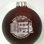 HB3D designed ornaments have a building cutout larger from the image circle and text typeset in circular path